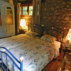 A bedroom of holiday cottage Bergerie