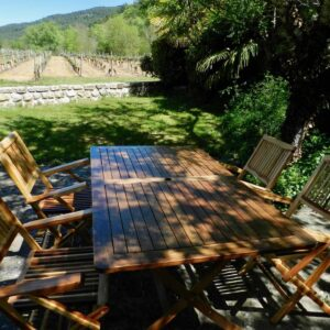 The terrace of holiday cottage Bergerie with outside table, chairs and view of the vineyard
