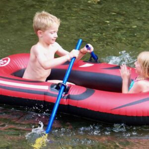 Two boating children on the river in an inflatable rubber boat