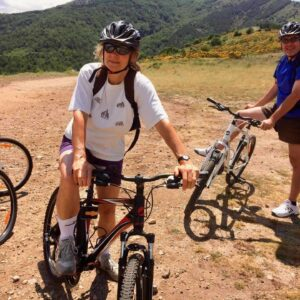 People ready to start riding on a mountain bike.