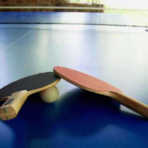 Ping-pong table with ball and two ping-pong bats
