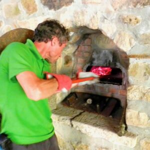 Making pizza in the wood-fired oven