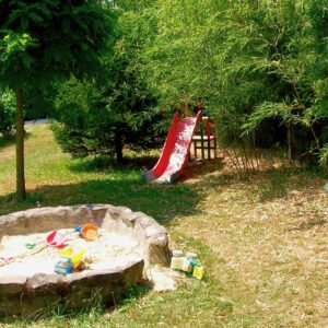 Children's playground with sandpit and slide