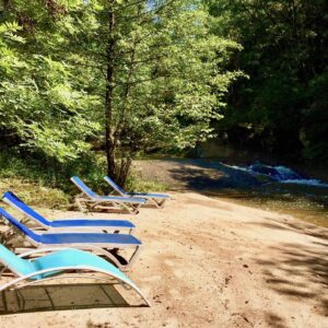 Private natural sandy beach with deck chairs