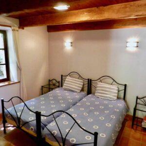 Schlafzimmer im Erdgeschoss des Ferienhauses l' Orangerie