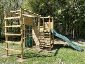 Playground with slide and climbing net