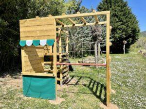 Playground with horizontal bar and climbing net
